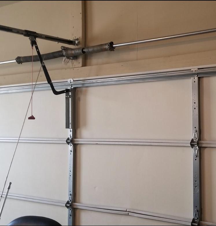 AAA Garage Door Repair - Garage Door Spring Replacement